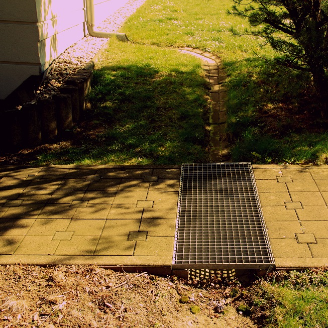 Drainage installations for diverting surface water away from buildings and increasing retention an infiltration Image